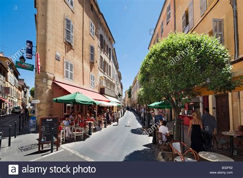 cafes on rue d italie in the historic city centre aix en stock photo royalty free image
