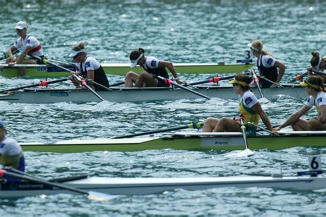 Quad Row Boat by Rower Rows Toward Rowing Victory In A Rowboat News