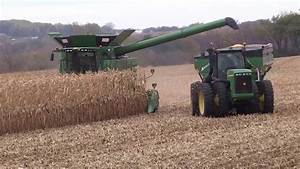 Grain Cart - corn on the move from combine to unloading in ...