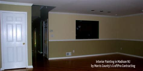 two tone accent wall painting with chair rail molding in