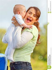 Baby Girl Kissing Holding Her Happy Mother Stock Images ...