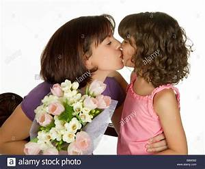 Happy mother kissing her daughter on mother's day Stock ...