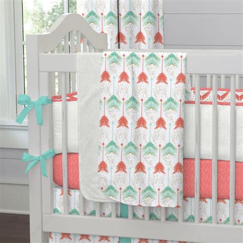 coral and teal arrow crib blanket carousel designs