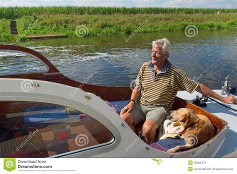 Dog Motor Boat man and dog in boat stock photo image of baot motor