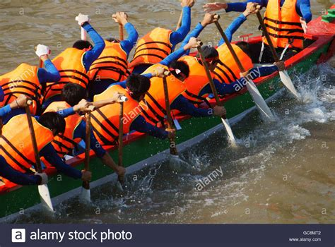 Row The Dragon Boat teamwork of man rowing dragon boat in racing try to row