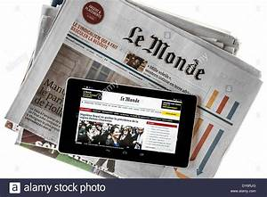 Touchscreen digital tablet showing online world news on ...