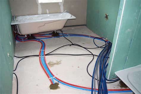 installation de plomberie dans la salle de bain espace architectes et immobiliers
