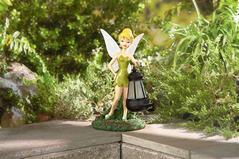 disney statue with solar lantern tinkerbell limited availability outdoor living outdoor