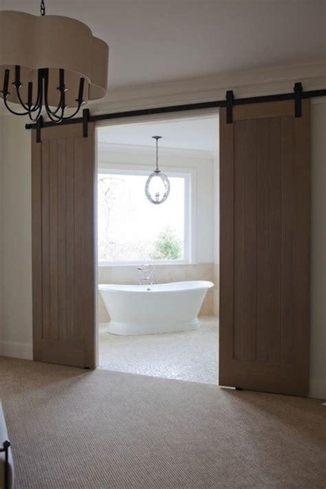 barn door for bathroom bathroom barn doors transitional bathroom baines