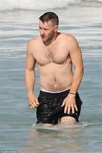 Joel Edgerton shirtless dashing into the water for a ...