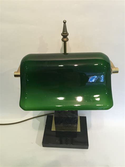 brass banker s desk l with a green glass shade brass
