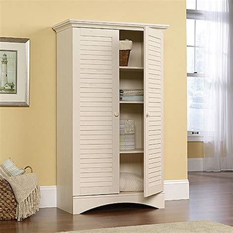 sauder harbor view antiqued storage cabinet 400742 the