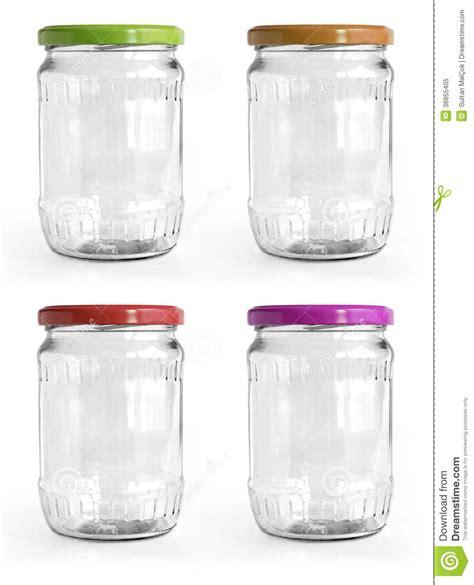 pot en verre vide avec le couvercle en aluminium au dessus du fond blanc photo libre de droits