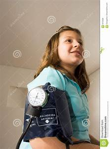 Girl Gets Her Blood Pressure Taken-Vertical Stock Photo ...