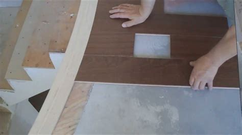 how to install hardwood floor around curved stair nosing