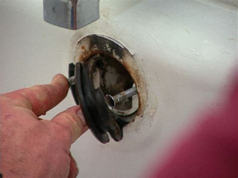 how to replace a bathtub overflow gasket and caulk a