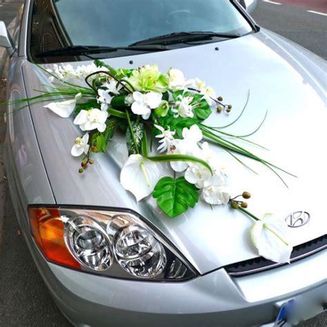 wedding car decorated with an artificial silk flower arrangement bridal car