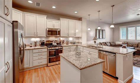 Traditional Kitchen With Raised Panel & Kitchen Island In