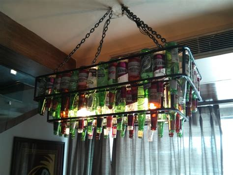 Beer Bottle Chandelier @ Xiian,delhi Bathtub Clog Remover How To Clean Mini Blinds In Celebrity Found Dead Much Water Does A Standard Size Hold Toilet And Backing Up Apartment Fixtures Wall Mount Putting Wood Around Best Caulk