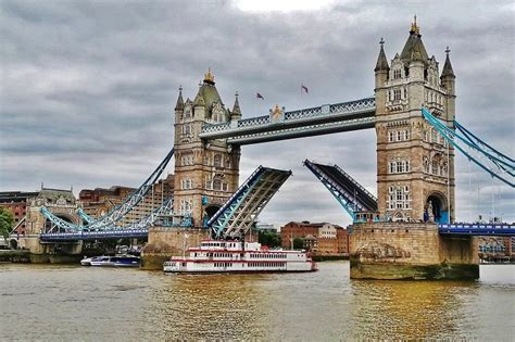 Boat Going Under Tower Bridge by Cool Facts About Tower Bridge London England