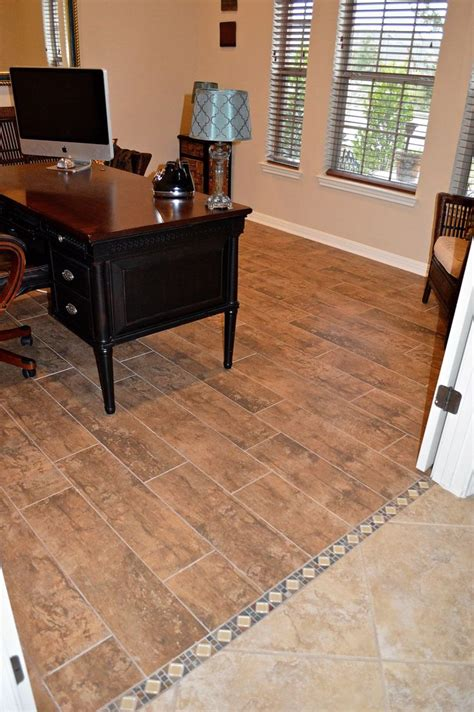 replace carpet with tile that looks like wood planks we used a decorative tile border to