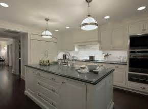 white kitchen cabinets with gray countertops