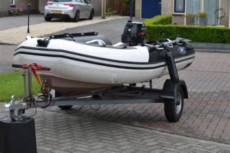 Trailer En Buitenboordmotor by Mooie Ribboot Trailer En Buitenboordmotor Advertentie 562207