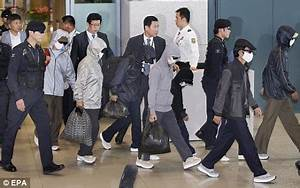 Masked North Korean refugees arrive in the South for ...