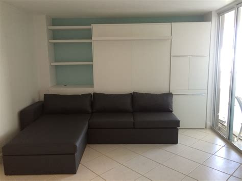 furniture white wooden murphy bed with green sofa and