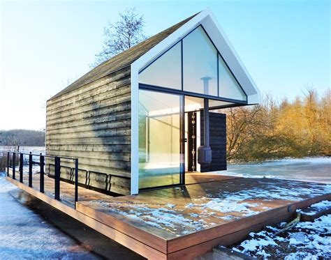 Best Cabin Boats Under 50k by Tiny Glass And Timber Cabin Cleverly Folds Open To Blend