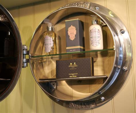 chadder co porthole mirror cabinet filled with the stunning penhaligons soaps and fragrances
