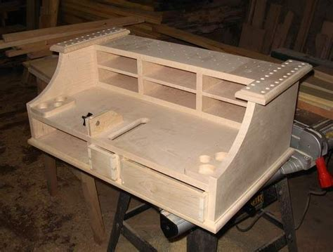 fly tying bench with a trash bin fly tying station