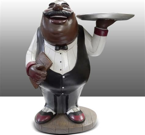black chef kitchen statue holding plate table decor