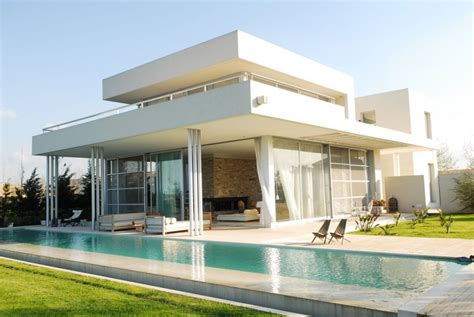 exterior modern white agua house with pool interior