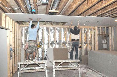 basement remodel day 4 hanging taping mudding drywall