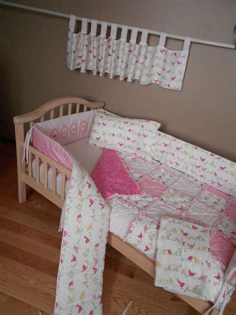 baby pink penelope bird fabric from pottery barn crib