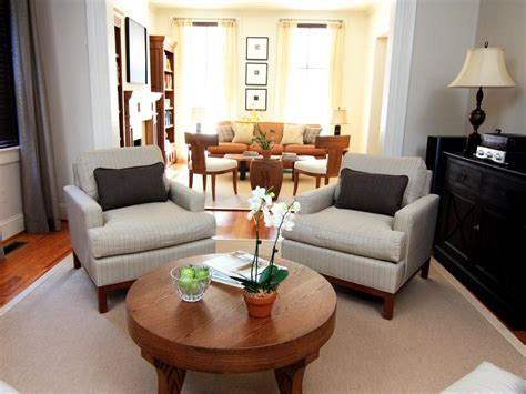 transitional living room with comfy chairs hgtv