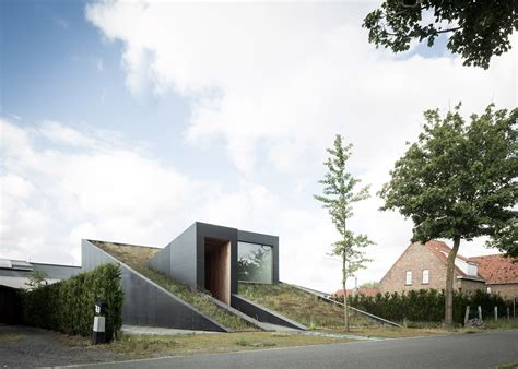 Slope Level by Sloped Green Roof Covers Split Level Home