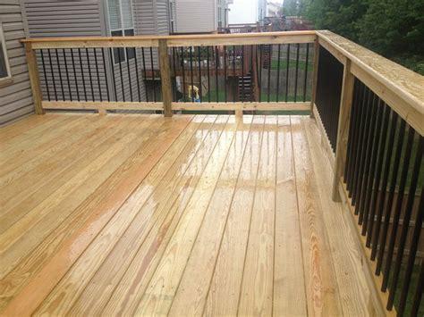 black metal aluminum spindles on 12x16 deck with premium wood decking deck patio ideas