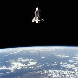 """The Earth-orbiting space shuttle Challenger beyond the ..."
