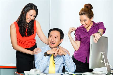 Asian Womanizer Boss Flirting At The Office Stock Image