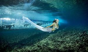 A photographer has captured models swimming through the ...