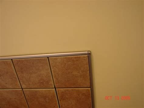 chrome schluter edge to finish tile instead of bullnose bathroom ideas copper