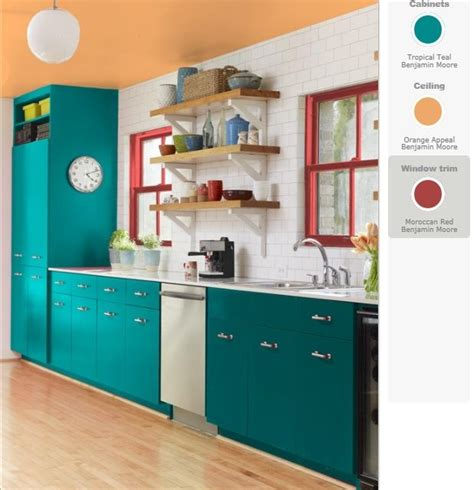teal and yellow orange kitchen teal cabinets