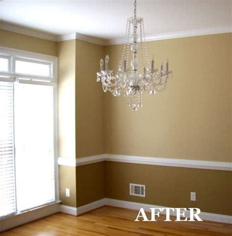 two tone dining room with chair rail light color above