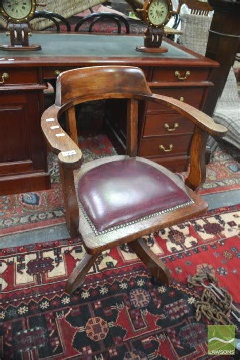 captains chair with leather seat