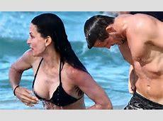 Courteney Cox pops out of her bikini as Josh Hopkins