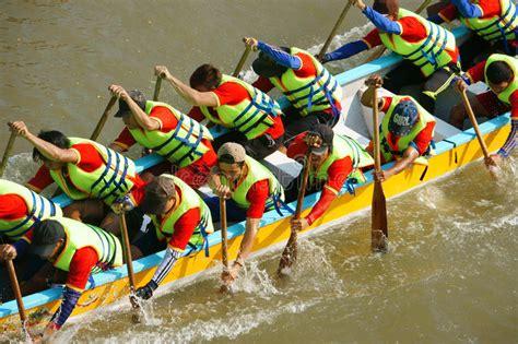 Dragon Boat Racing Vs Rowing people in activity rowing dragon boat in racing editorial