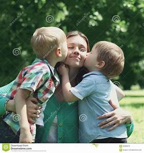 Moment Of Happy Mother! Two Children Sons Kissing Mom ...