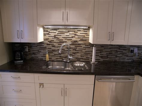 Black Granite With Glass Backsplash